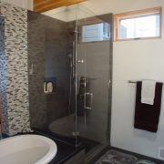 Master Bath shower, beamed ceiling and frameless shower enclosure