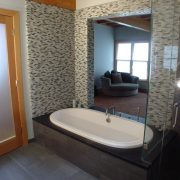 Mst Bath sliding door open to bedroom and view beyond