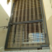 New security door pattern of oxidized stainless steel and bronze rod