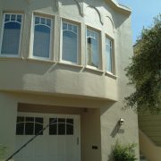 New garage door and landscaping improve streetscape
