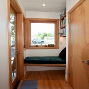 Rear entry with window seat and laundry closet.