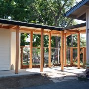 Covered walkway between house & garage/studio.