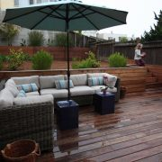 View of seating group on deck, with play/gardening area beyond