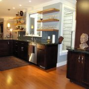 Dark stained lower cabinets and light stained shelves compliment the space