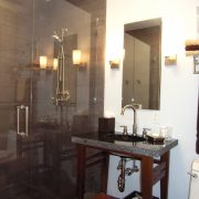 Main Bathroom remodeled with subtle features such as open cabinetry and simple detailing