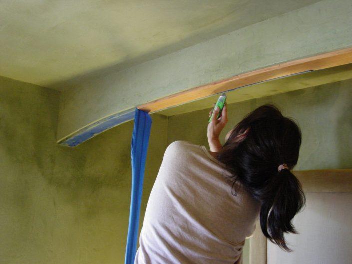 Removing masking tape, exposing trim