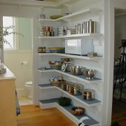 Open shelves workng as pantry storage