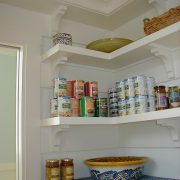 Detail at open shelves working as pantry storage