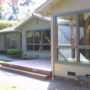 View of Mst Bedroom addition, shared deck and new windows at main house